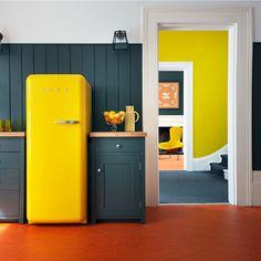 Grey and yellow kitchen with Smeg fridge