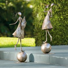 Create a graceful focal point in your garden; each Dancing Garden Girl outdoor sculpture comes to life with spiraling hair and balances beautifully upon a    weighted sphere.            Outdoor sculpture captures the whimsical nature of a girl dancing in the garden                Crafted from 100% steel                Unique all-weather antiqued silver finish                Each is 39 tall                Mounted on a weighted base that connected to a pool-shaped platform