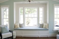white built-in window seat love - adore the undressed windows, the awesome light and the stripe cushions for a coastal / nautical feel x