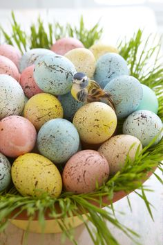 Speckled Eggs  The look almost as true as eggs found in a bird's nest.    Easy DIY Easter egg decoration!    Dye the eggs using soft pastel colors - Just a few minutes in the bath. Allow to dry.    Be sure to cover yourself and working surface.    Using a watered down sepai brown acrylic paint, take an old toothbrush and run your finger along the brush to splatter the paint.    Place in a terra cotta dish with a ring of wheat grass around the edge of dish.