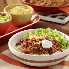 Beef Taco Quinoa Bowl: A quinoa bowl recipe with taco seasoned beef, tomatoes and cheese topping quinoa