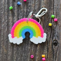 Adorable and oh so easy!  These rainbow perler bead keychains are a perfect pop of color for backpacks or lunchbags.