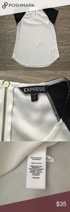 Black & White Express Blouse Lightweight, flattering white blouse with black cap sleeves. Adorable with skinny jeans or dress pants! Slight discoloration near the neckline. Price reflects the blemish. Express Tops Blouses