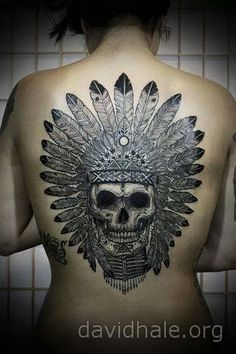 I want a skull headdress tattoo