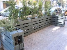 double pallet fence with plants on top