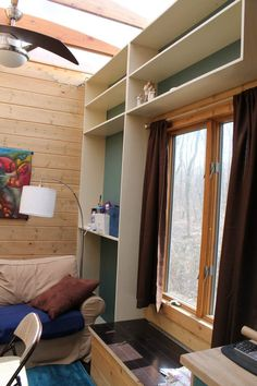 """My friend Nate originally bought a camper that he dismantled to build the tiny house on a trailer you're about to see. The trailer is 8'3″ by 24'10"""" and he used 2x4s i…"""