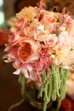 Romantic peach bridal bouquet with garden roses, astilbe, peonies, cymbidium orchids, amaranthus and dahlias.