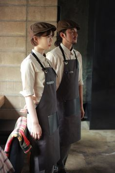 Love this for the hat, shirt, and especially the apron. A stylish butcher's apron is something I'm interested in incoporating; Cafe Uniform, Waiter Uniform, Uniform Shop, Barista Cafe, Kellner Uniform, Bartender Uniform, Staff Uniforms, Work Uniforms, Leather Apron