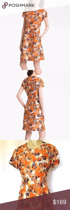 """HUGO BOSS Black 'Denirali' Silk Dress Orange 12 HUGO BOSS Black Label 'Denirali' Silk Dress  A splashy floral print enlivens a short-sleeve dress of slubbed silk tailored in a fit-and-flare silhouette with retro-femme appeal.  Back zip closure Front pleating Side pockets Fully lined Silk; dry clean Excellent condition! Size: 12 Pit to pit: 21"""", Waist: 18"""", Hips: 23"""", Length: 38"""" The measurements were made with clothing laying flat Boss Black Dresses Midi"""