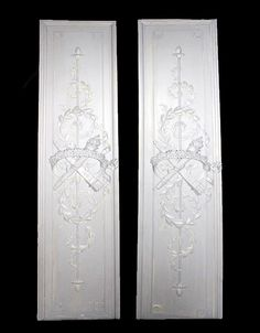 a-pair-of-carved-wood-panels