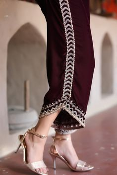 Introducing these maroon velvet curved trousers with cutwork and crystal embroidery on flare and sides, creating a twist from the traditional cut. Velvet Pakistani Dress, Pakistani Dress Design, Pakistani Fashion Casual, Pakistani Outfits, Fashion Pants, Women's Fashion Dresses, Sharara Designs, Salwar Pants, Indian Gowns Dresses