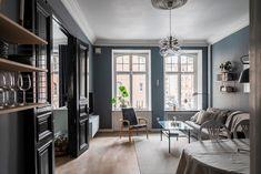 AlvhemKastellgatan 16B - Linnéstaden - Alvhem Classic Window, Blue Curtains, Swedish House, Two Bedroom Apartments, Black Doors, Blue Walls, Scandinavian Interior, Brick Wall, Living Room