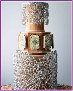 Last year at the 2016 Oklahoma Sugar Arts Show, Ted Scutti debuted a masterful cake inspired by the Mad for Metallic's theme of the show. This stunning design featured ornate silver cages. We share some close-ups of Ted's gorgeous cake.