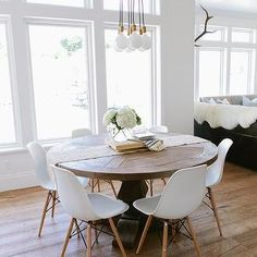 Round Salvaged Wood Dining Table with Brass City Chandelier 7