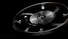 """OMEGA - Speedmaster MOONWATCH Co-Axial Chronograph """"Dark Side of the Moon"""" The silicon balance spring"""