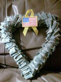 I made this wreath out of ACU fabric from one of my husbands old uniforms he gave me. i thought it turned out really cute.  https://www.facebook.com/MissbersCreativities