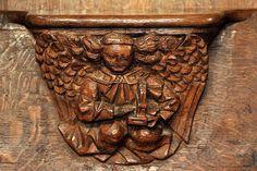 Miséricorde. Ange jouant de l'orgue.