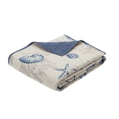 The Madison Park Bayside quilted throw creates a casual coastal look. The throw features assorted seashells accentuated with light and dark blue coloring ...