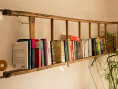 In the sense of upcycling, an old ladder is being converted into a new bookshelf The post Bookshelf – shelf of old ladder appeared first on Garden ideas - Upcycled Home Decor Old Ladder Shelf, Ladder Bookshelf, Pallet Shelves, Bookshelves, Recycled Furniture, Pallet Furniture, Kitchen Furniture, Upcycled Home Decor, Diy Home Decor