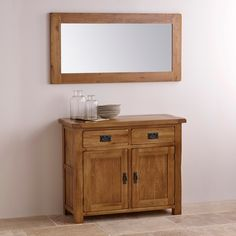 "This 47"" x 23.5"" mirror is framed with top-quality oak and expertly distressed to give it a beautiful, rustic finish"