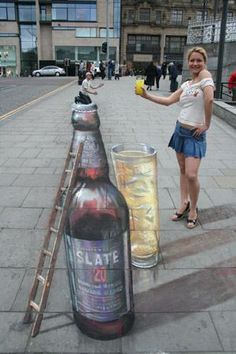 Chalk drawing look closey to see Julian Beever (artist) on the top of the Bottle