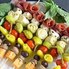 These antipasto skewers are the perfect lazy day appetizer. They can easily be made from store bought pickled items or from your pantry stash! | honeyandbirch.com