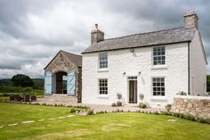 A Luxurious Farmhouse in Wales - what a dreamy little cottage! I love the painted limestone wall and slate roof - classic welsh style