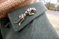 vintage tiger brooch on collar