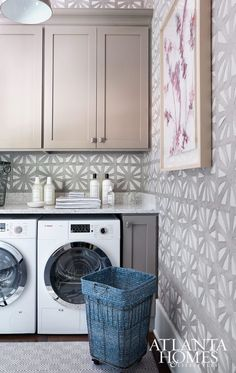 Jazzing up the laundry room with decorative wall paper. Who says laundry rooms have to be plain and boring?