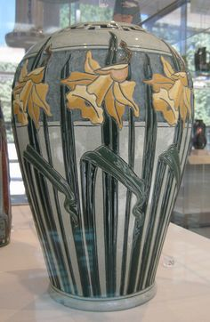 Roseville Pottery, Della Robbia vase with daffodils, designed by Frederick Rhead.