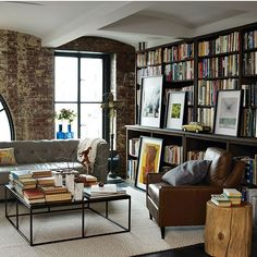 even though i don't like reading, i have always wanted a large book library and study like this....weird.