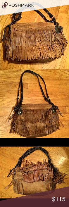 Hogan suede tassel handbag Italian-made. Has three inside pockets, two of which zipper. Zippers work and have suede handles. Shoulder straps are adjustable. HOGAN logo on both sides of purse as well as inside. Minor wear. No missing tassels. Purse is a caramel/tan color with darker brown straps. Hogan Bags Shoulder Bags