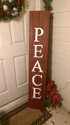 PEACE porch sign that I made this year to add to our Christmas decor. Two fence boards cut down, sanded and painted (I used red over a black base). I printed the letters and used pencil shading on the back of the paper in place of copy paper to trace the letters on the board. Then I painted the letters on with a small brush.