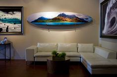contemporary living room decor with painted surfboard on the wall; nautical decor; coastal living