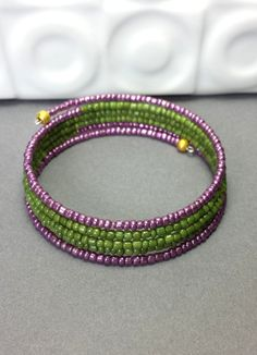 Hey, I found this really awesome Etsy listing at https://www.etsy.com/listing/191513956/purple-green-seed-bead-bracelet-amethyst