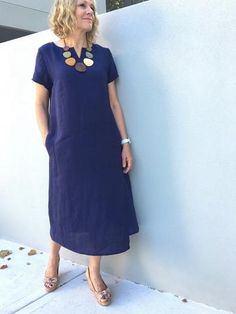 Jane Dress –This a-line dress features a smallneckline split, short sleeves and a si...