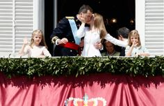 A tender moment between the new king and queen of Spain. Letizia affectionately holds her husband's face in her hand as they share a kiss on the palace's balcony. Photo: © Getty Images