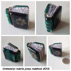 Miniature book, minibook with glass cover and spine. Genuine leather for the spine. Handbinding, paper handtorn. Glass is fused at Heleen van der Spek in Leiden. Front has a Sizzix button die in the glass from metal sheet.