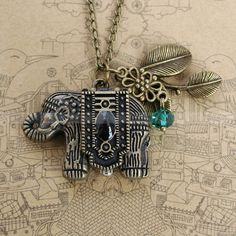 Vintage pocket watch necklace of antique bronze elephant