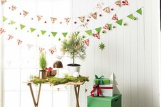 Create festive bunting simply by using Christmas wrapping paper! It's a super simple way to add a festive feel to your home!