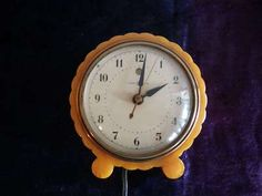 General Electric Butterscotch Catlin Clock 7H80 Runs.  See it on EBAY!