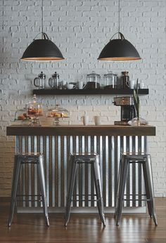 Tre pendants contrast nicely against the white exposed brick wall Coffee Bars In Kitchen, Coffee Bar Home, Home Coffee Stations, Coffee Shop, Industrial Cafe, Modern Industrial, Cafe Interior, Exposed Brick, Luxury Kitchens