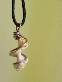 Wire Wrapped Yellow Spiral Shell on Black Suede Cord. $15.00, via Etsy.