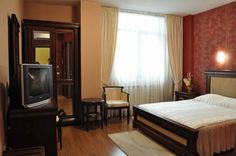 Acapulco Hotel Ploiesti Centrally located in Ploiesti, Hotel Acapulco offers elegantly decorated, air-conditioned accommodation with spacious bathrooms, cable TV and free Wi-Fi in the entire property.  For your convenience, free parking is provided.