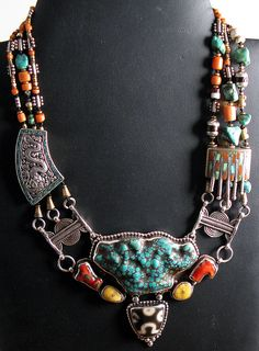 Finely worked Necklace made from silver with amber, Agate, coral and  turquoise.  Handcrafted in Nepal using traditional Tibetan designs