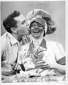 "Desi licks the chocolate off Lucille's face after she finished filming the classic chocolate factory scene. | 21 Wonderful Behind-The-Scenes Photos Of ""I Love Lucy"""