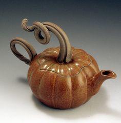 There's also a creamer & sugar set.  >^__^<  Handmade Stoneware Pottery Pumpkin by baumanstoneware