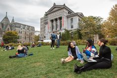 Canadian universities with the highest acceptance rate: students sitting on the turf