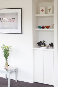 Inset built-in bookcases, great for displaying prized possessions and fit so neatly with the home!