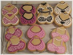 A friend is attending a Breast Cancer fund raiser party.  All the girls are wearing decorated bras outside their clothing.  She found some lingerie cookies online so asked if I could make her some.  Thanks to the inspiration of many, many wonderful + fun designs already on Cake Central, I was able copy and to do some for her.  NFSC with Antionia74 royal icing flood + trims.   Thanks for looking.